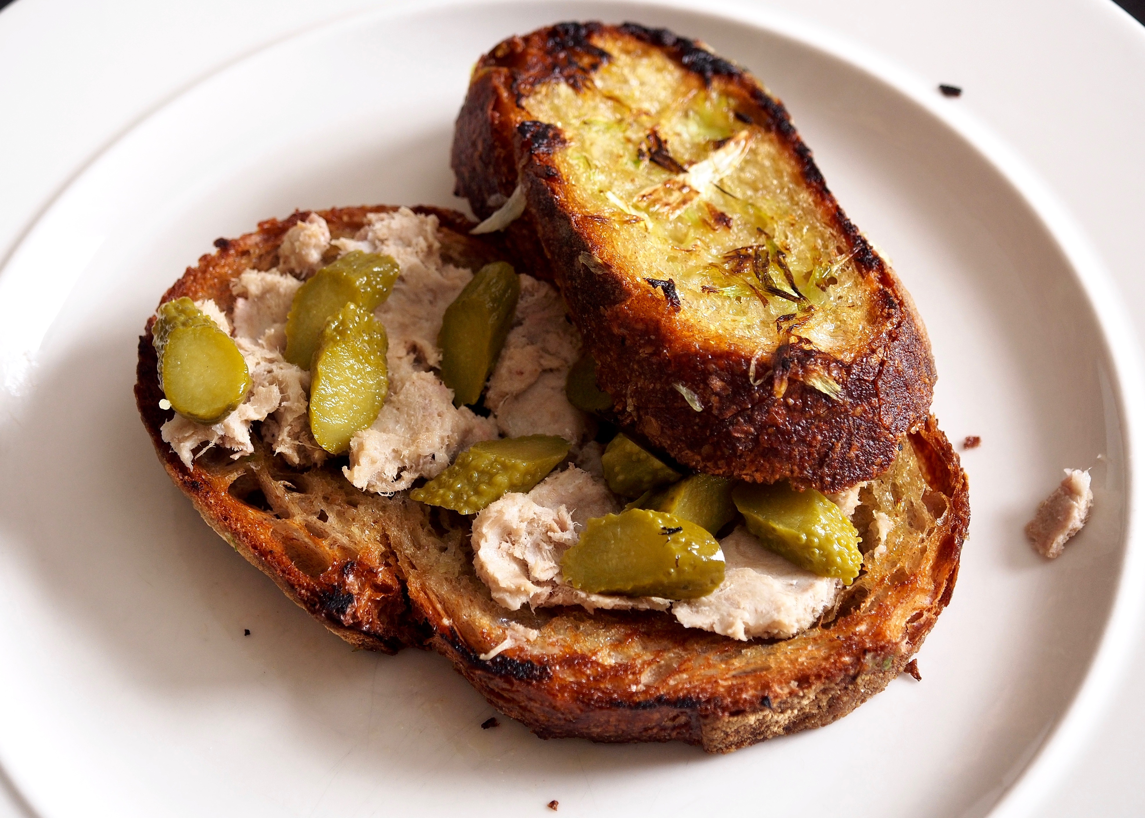 Rillette & cornichon on scallion toast