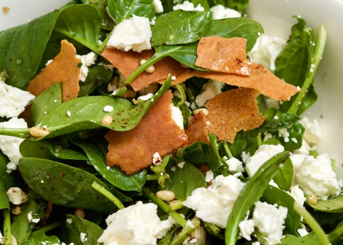 Feta salad with spinach, crispbread, sumac & pinenuts