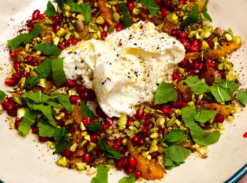 Burrata with burnt orange, pistachio and pomegranate