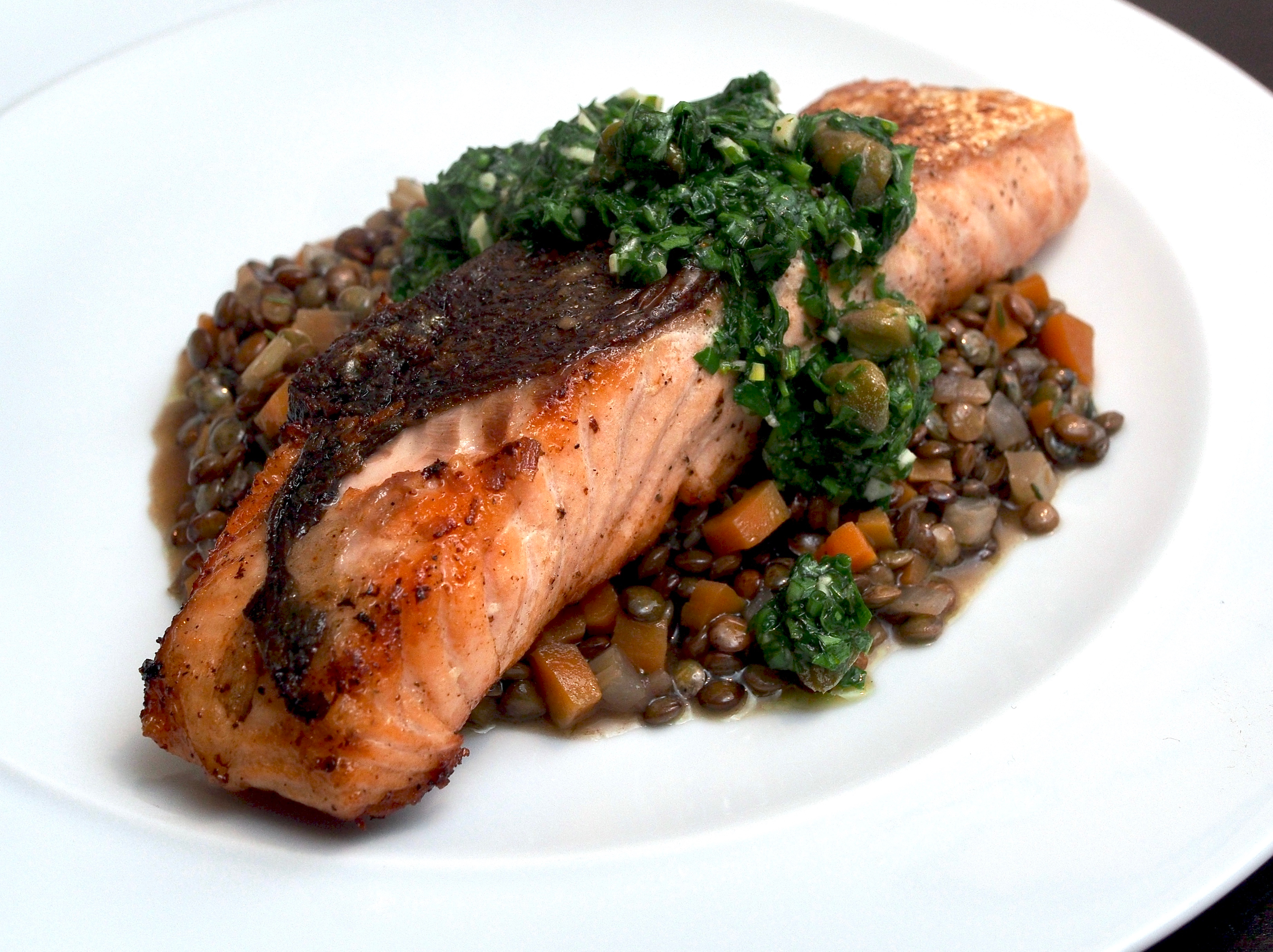 Salmon on lentils with herb relish
