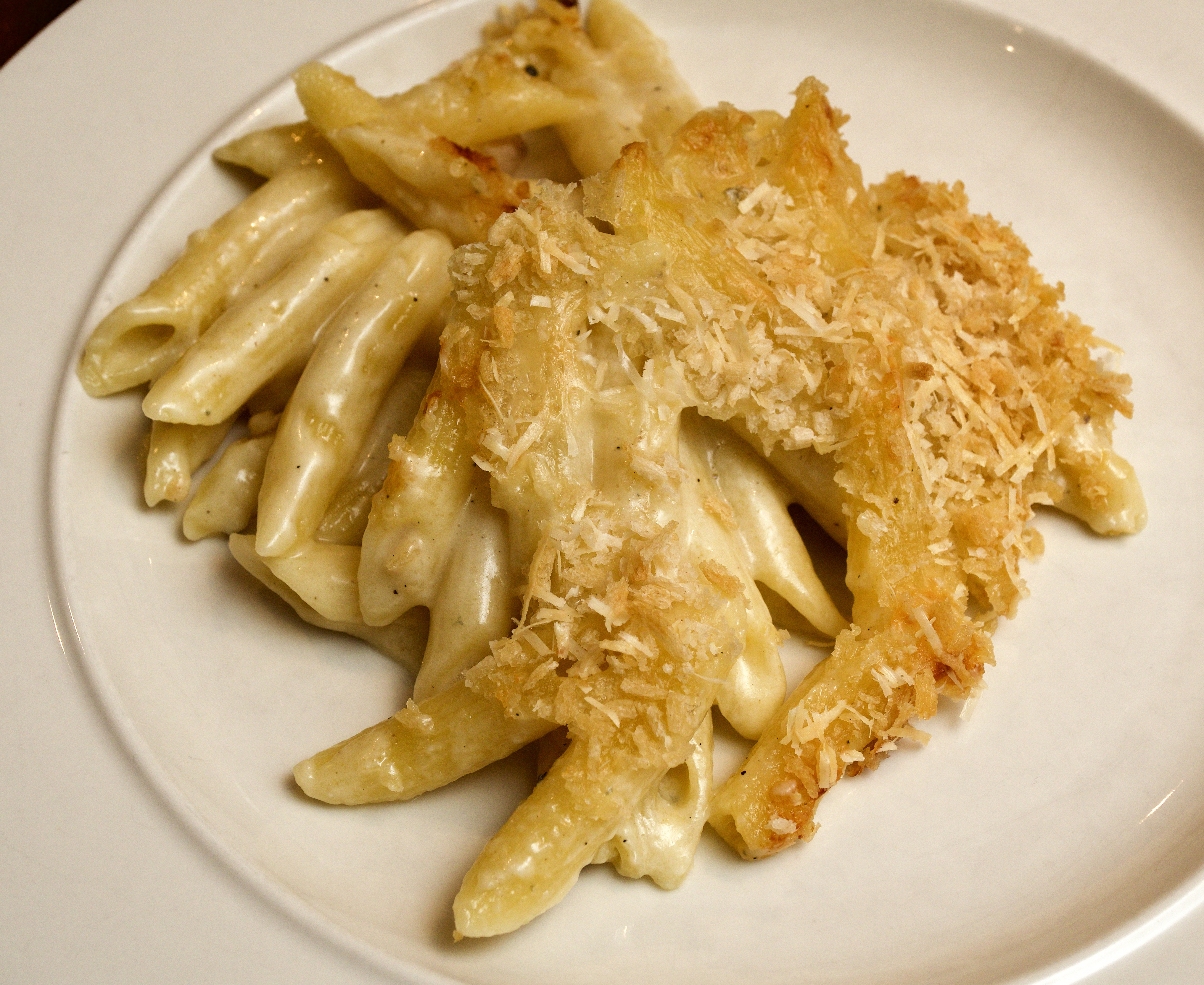 Penne baked with three cheeses
