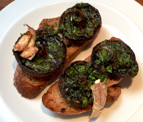 Mushrooms baked on toast with herbs, butter & garlic